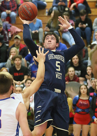 (Brad Davis/The Register-Herald) Greenbrier West's Cody Lewis turns and shoots as Midland Trail's Liam Gill (arm up) defends Friday night in Hico.