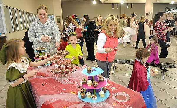 Rick Barbero/The Register-Herald Sugar Plum Fairy Tea Party was held at Lewis Automotive Group, on 100 Appalachian Dr in Beckley Sunday afternoon. Guest enjoyed tea with Clara, the Sugar Plum Fairy and other characters from The Nutcracker. The characters also performed ballet from the show. This was a benefit event for the Heather Zickefoose Scholarship fund to aid talented students to be professional dancers.