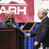 Jeff Miller, left, presents David Darden the Outstanding Leadership, Dedication and Service in 2017, during the 98th annual Beckley-Raleigh County Chamber of Commerce Annual Dinner at the convention center in Beckley Friday.(Chris Jackson/The Register-Herald)