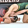 (Brad Davis/The Register-Herald) Greenbrier East's Nick Thomas takes on Oak Hill's Max Underwood in a 182-pound weight class matchup during the Raider Rumble Saturday afternoon in Glen Daniel. Greenbrier East's Thomas won the match.