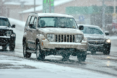 (Brad Davis/The Register-Herald) Heavier snow begins to come down in Beckley during the afternoon hours Sunday.