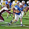 (Brad Davis/The Register-Herald) Midland Trail's Colton Yoder rumbles past Sherman's Lance Hudson for one of his key carries of the second half Friday night in Fairlea.