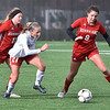 (Brad Davis/The Register-Herald) Hurricane's Maddie Pifer, right, keeps the ball from Wheeling Park defender Annie Parsons (middle), who cuts between her and teammate Ann Marie Ramey, left, in pursuit during the Class AAA Girls State Championship match Saturday morning at the YMCA Paul Cline Memorial Sports Complex.