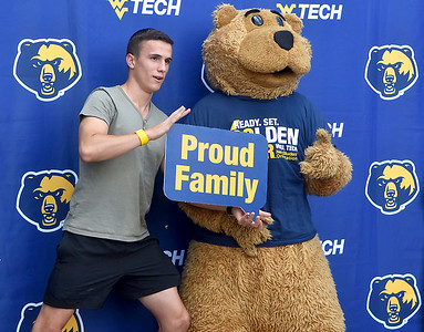 (Brad Davis/The Register-Herald) Australia native and incoming mechanical engineering student Jason Constable strikes a pose for photos with Monty the mascot at the conclusion of WVU Tech official move-in day Sunday.
