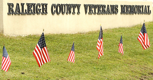 Flags line the roadside at the Raleigh County Veterans Memorial in Coal City. Jon C. Hancock/for The Register-Herald