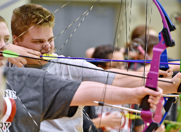 (Brad Davis/The Register-Herald) Cedar Grove Middle School archer D.J. Morris takes aim during a tournament at Shady Spring Middle School Saturday morning.