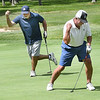 Ray Richards, left, reacts along with Sam Corey, reacts after Corey sunk a 10 ft putt for birdie on the par 4, 8th hole on the Cobb Course during the 16th annual Bunkers Open held on the Cobb and Stonehaven Courses at The Resort at Glade Springs Tuesday. The four man scramble with thirty teams was won by Tudor's Biscuit World in a shootout against First Cummity Bank.<br /> (Rick Barbero/The Register-Herald)