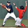 (Brad Davis/The Register-Herald) Nicholas County shortstop Jacob Grose forces out Liberty's Logan Williams at second, but Liberty batter Timmy Daniels would be safe at first to prevent a double play Wednesday evening at Linda K. Epling Stadium.