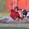 (Brad Davis/The Register-Herald) Liberty's Nathaniel Griffith rushes in and slides home before Oak Hill catcher Dakota Shreve can reach him with the tag after a pitch in the dirt skipped loose with Griffith on 3rd during the second game of a doubleheader Friday evening in Oak Hill.