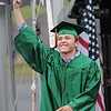 Samuel Aultz celebrates after receiving his diploma from Greenbrier East High School at the 52nd Annual Commencement ceremony in Fairlea Friday. Jenny Harnish for the Register-Herald