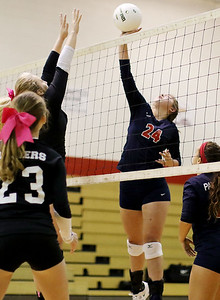 Chris Jackson/The Register-Herald Independence's Madison Testement (24) strikes a ball over a Liberty player during their match at Independence High School.
