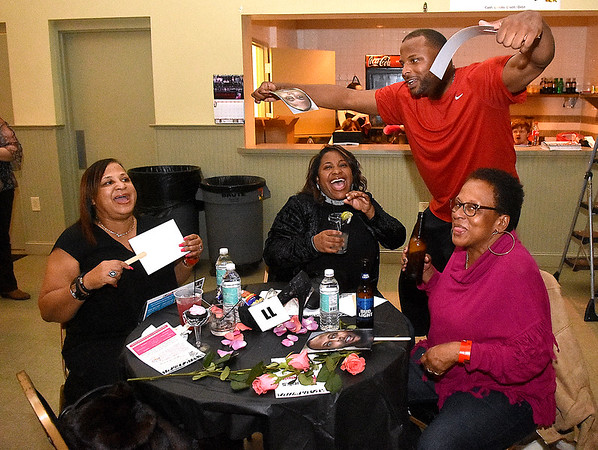 (Brad Davis/The Register-Herald) Kelvin Pannell gives his fans what they want during the annual Hunks in Heels fundraising event for the Women's Resource Center Friday night at the Beckley Moose Lodge.