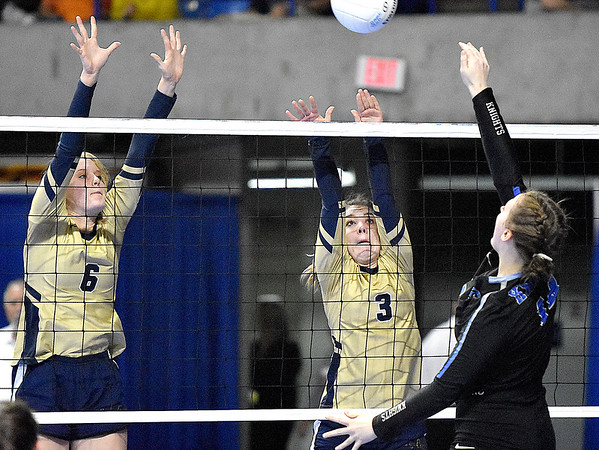 (Brad Davis/The Register-Herald) Greenbrier West's Kenzie O'Dell, left, and Logan Vandall leap to block a spike from Tyler Consolidated's Victoria Hood during State Volleyball Tournament action Friday morning at the Charleston Civic Center.