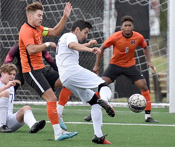 (Brad Davis/The Register-Herald) WVU Tech's Cristian Cubedo Aymerich turns to fire a shot on goal as Milligan's Roberto Fernandez Garrido, left, defends Saturday afternoon at the YMCA Paul Cline Memorial Sports Complex.
