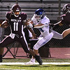 Nate Grayton, of Woodrow Wilson, left, breaks away for a touchdown during first half action against Princton Friday at VanMeter Stadium in Beckley.<br /> (Rick Barbero/The Register-Herald)