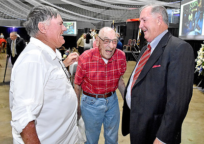 (Brad Davis/The Register-Herald) Tracy Hylton, II, right, shares some good laughs with Gerald H. Hildebrand, who was both dear friends with and an employee of his father's, the late Tracy Hylton Sr., for the better part of 45 years along with his son Gerald B. Hilderbrand, left, who was also very close with him during the opening moments of a memorial service Friday afternoon at the Beckley-Raleigh County Convention Center.