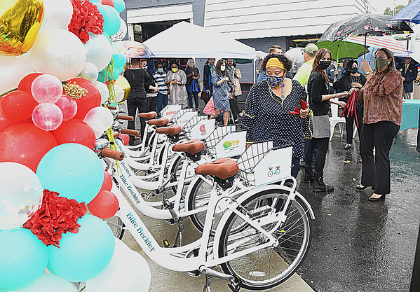 VIckie Webb, volunteer director Beckley Welcome Center, looks of the bikes for the new Bike Share Program offered at the Beckley Welcome Center on Prince Street.<br /> (Rick Barbero/The Register-Herald)