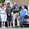 Members of the U.S. Marshall Fugitive Task Force, speaks with neighbors on Westwood Drive in Beckley Thursday morning after arresting a fugitive at 219 Westwood Drive.<br /> (Rick Barbero/The Register-Herald)