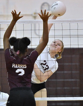 (Brad Davis/The Register-Herald) Woodrow Wilson's Savanna McMillion rips a spike as George Washington's Maya Harris leaps to block it during the Class AAA Regional Volleyball tournament Saturday afternoon in Beckley.