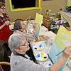 "(Brad Davis/The Register-Herald) Mt. Hope residents Ramona Brown, right, and Dolly Lilly spend a Sunday painting what will eventually be a scene of hot air balloons in an afternoon sky using acrylics on canvas as instructor Lynsi Boyd helps them with tips and tricks during a studio painting session at 110 Marshall in Beckley. The art studio and music venue usually has similar paiting parties on Friday nights scattered throughout the year, including some Sundays. Painting sessions are often themed in a variety of ways designed to help painters build skills in painting certain types of objects or textures, with yesterday's being ""Up, Up an Away"" in reference to the balloons. Similar upcoming painting events will be ""Peaceful River"" on Monday, March 27 at 6:00 p.m. and ""Angel Wings"" Friday, April 7 at 6 p.m. Keep an eye on their facebook page or give them a call at 304-634-8367."