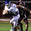 Grant Cochran, of Princeton, breaking away for some yardage against Woodrow Wilson Friday night at VanMeter Stadium in Beckley.<br /> (Rick Barbero/The Register-Herald)