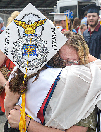 F. Brian Ferguson/Register-Herald  Independence Graduate Alexis Clark, left, gets a hug from her good friend Sydney Daniels, right, after Saturday's graduation in Independence.