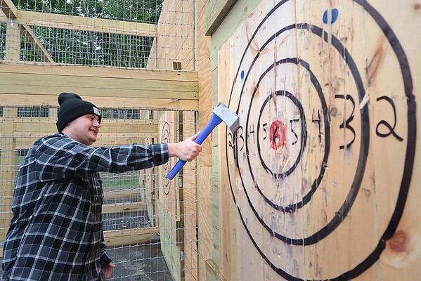 Axe throwing specialist Jared Wood demonstrates the Axe throwing range at the new Adventure Zone in Pipestem Resort State Park Saturday. The Adventure Zone offers 3D Archery, Miniature Golf, Disc Golf, Remote-Controlled Cars and Trucks, Drone Flying, Laser Tag and Skeet Shooting and Motor Assisted Mountain Bikes. The Adventure Zone is open seven days a week and all equipment is provided. Jenny Harnish for the Register-Herald