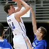 (Brad Davis/The Register-Herald) Team C. Adam Toney's (Class A) Noah Minor pulls up for a jump shot as Team Jan-Care's (Class AA) Kyle Saunders defends during the Scott Brown Classic Saturday night at the Beckley-Raleigh County Convention Center.