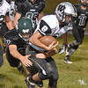 (Brad Davis/The Register-Herald) Westside's Dalton Estep is caught and tackled by Wyoming East's Wyoming East's Clay Lester Friday night in New Richmond.
