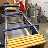 Michael Deckner, Appalachian Headwaters,  begin the extracting process for making honey at Camp Waldo in Hinton<br /> (Rick Barbero/The Register-Herald)