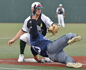 (Brad Davis/The Register-Herald) Miners infielder Maddux Houghton gets the tag and the out on Butler baserunner Andrew Chuba despite an acrobatic move to try and avoid it Wednesday night at Linda K. Epling Stadium.