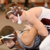 (Brad Davis/The Register-Herald) Woodrow Wilson's Ethan Osborne takes on George Washington's Andrew Temple in a 138-pound weight class matchup during the Raider Rumble Saturday afternoon in Glen Daniel. Woodrow's Osborne pinned Temple to win the match.