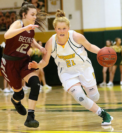 (Brad Davis/The Register-Herald) Greenbrier East's Kate Perkins starts a drive at the perimeter as Woodrow Wilson defender Cloey Frantz keeps pace Saturday night in Fairlea.