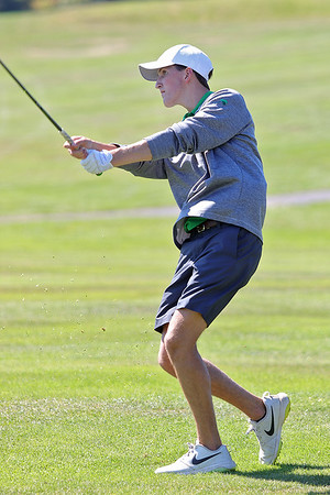 Charleston Catholic's Warner Murad looks after his tee during the Class A Region 3 golf tournament at Pipestem Resort State Park Monday. Jenny Harnish/The Register-Herald