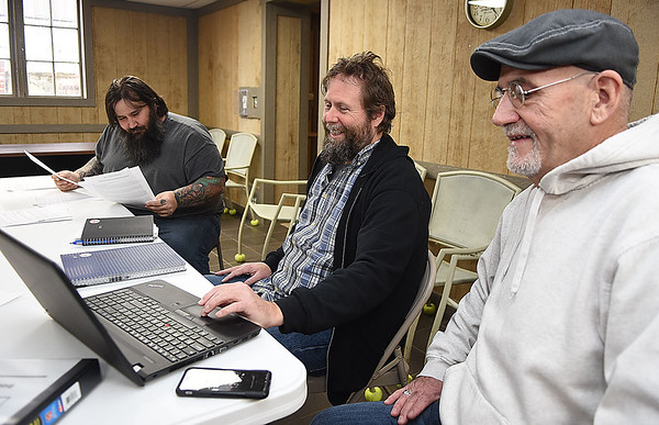 Vince Loudy, program cordinator, left, Ron Campbell, associate director and Chuck Salmons, executive director Southern West Virginia Fellowship Home have a staff meeting at the home Monday morning.<br /> (Rick Barbero/The Register-Herald)