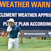 (Brad Davis/The Register-Herald) Whee Kim waves to the crowd after finishing up a hole as the video board behind warms of incoming waether during opening round action of the Military Tribute at The Greenbrier Thursday afternoon in White Sulphur Springs.