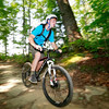 A boy scout mountain bikes along a skills course during the 2017 National Jamboree at the Summit Bechtel Reserve Thursday near Mt. Hope. (Chris Jackson/The Register-Herald)