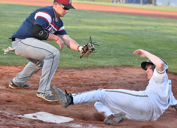 (Brad Davis/The Register-Herald) Shady Spring's Mason Palmateer slides back in before Bluefield 1st baseman Blake Cundiff can get the tag down following a pickoff attempt after the pitch from catcher Drake Mullins Wednesday night in Shady Spring.
