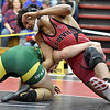 (Brad Davis/The Register-Herald) Oak Hill's Dominique Johnson takes on Greenbrier East's Nick Thomas in a 182-pound weight class matchup during the Coalfield Conference Invitational Friday night in Oak Hill. Oak Hill's Johnson won the match.