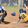(Brad Davis/The Register-Herald) WVU Tech baserunner Alexis Lopez hook slides around Ohio Christian catcher Christine Moyer to avoid the tag and score the game winning, walk-off run off the bat of teammate Kayla Jones during the second game of a doubleheader Friday afternoon at Woodrow Wilson High School.