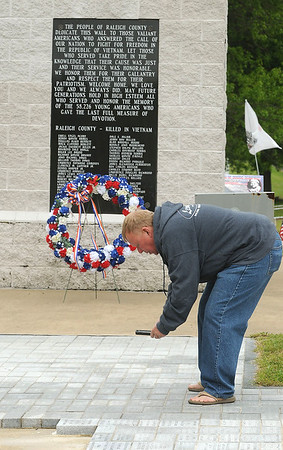 Gregory Ward, of Coal City, photographs a memorial brick at the Raleigh County Veterans Memorial. Wards father, Cecil Ward, is a living 101 year old WW II veteran who also attended the ceremony. Jon C. Hancock/for The Register-Herald