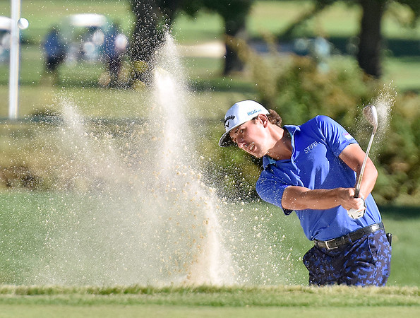 (Brad Davis/The Register-Herald) Kelly Kraft shoots from a bunker on 17 during the Military Tribute at The Greenbrier Sunday afternoon in White Sulphur Springs.
