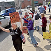 (Brad Davis/The Register-Herald) Area residents, doctors and healthcare advocates line the sidewalk outside of Senator Shelley Moore Capito's office at 220 North Kanawha Street as they protest the looming potential repeal of the Affordable Care Act Friday afternoon.