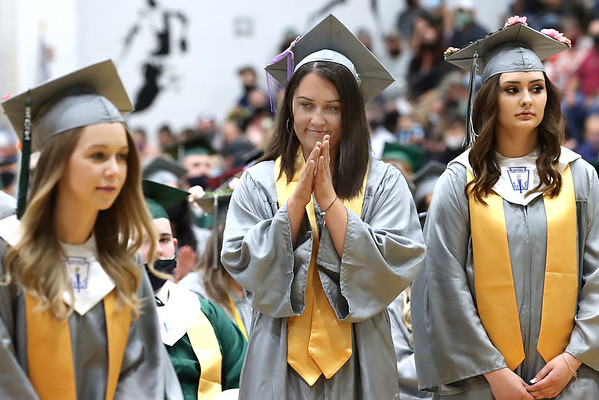 Rileigh Mullins, middle, and Alexis Walker on right during the Wyoming East graduation.<br /> Jim Cook for the Register-Herald