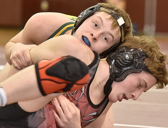 (Brad Davis/The Register-Herald) Greenbrier East's Cayden Hoover takes on St. Albans' Tyler Powell in a 113-pound weight class matchup during the class AAA Region 3 tournament Saturday afternoon at Woodrow Wilson High School. Greenbrier East's Hoover won the match.