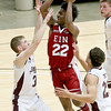 (Brad Davis/The Register-Herald) EIN's (National) Isaiah Francis drives to the basket as Crossroads Chevy's (Class AAA) Seth Brown, left, and Jerrod West defend during the Scott Brown memorial game Saturday evening at the Beckley-Raleigh County Convention Center.