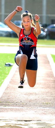 Rachael Vass competes in the long jump during a track meet at Woodrow. Jon C. Hancock/for The Register-Herald