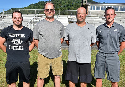 (Brad Davis/The Register-Herald) Westside head coach Darren Thomas, 2nd from left, with assistants Noel Cogar, Jared Cook and Quinn Miller.