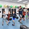 (Brad Davis/The Register-Herald) Young students pay attention and watch through the mirror in front of them as instructor Jamie Jesse demonstrates the proper technique for jabs and other punches during the first Kids Combat Cardio session to be held Sunday afternoon at the YMCA of Southern West Virginia. The one hour class will be held every Sunday in two age groups, kids 5-10 at 3:00 p.m., kids 11-18 at 4:00 p.m. and combines a fun workout environment with basic mixed martial arts training and techniques.