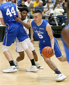 (Brad Davis/The Register-Herald) Team Jan-Care's (Class AA) Shane Jenkins, right, gets a screen from Westside teammate Corey Hatfield as he moves the ball up the court against Team C. Adam Toney (Class A) during the Scott Brown Classic Saturday night at the Beckley-Raleigh County Convention Center.